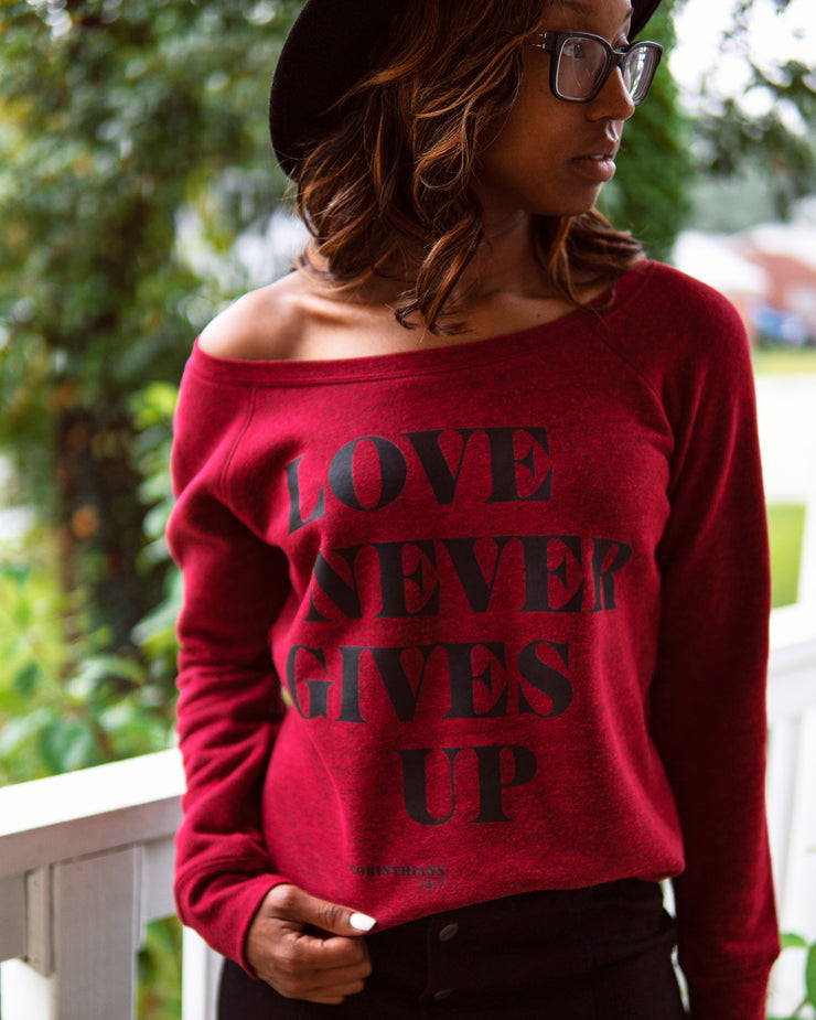 Love Never Gives Up Womens Sweatshirt