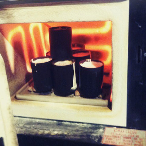 flasks in a hot kiln with red elements