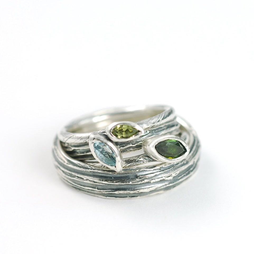 Peridot, Aquamarine and Tourmaline Vine and Leaf wedding or engagement rings with Tree Bark Ring by artisan Beth Cyr