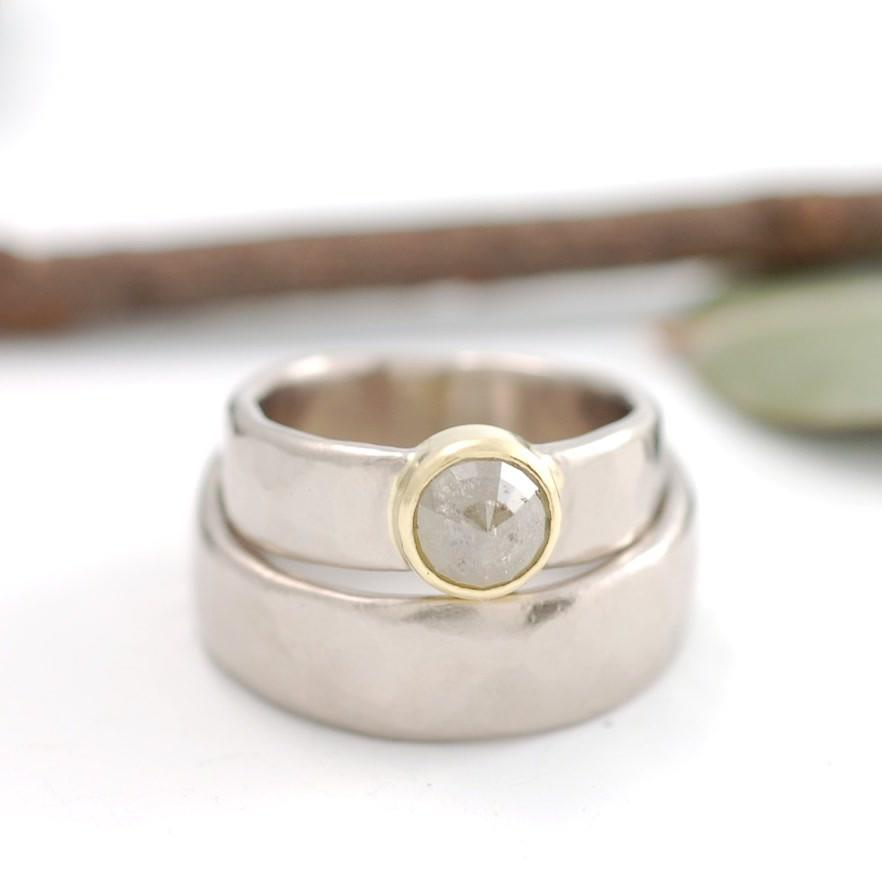 Custom 18k palladium white gold and yellow gold hammered wedding bands with rose cut diamond by artisan jeweler Beth Cyr