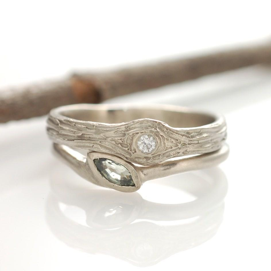 Tree Bark love knot ring in 14k palladium white gold with green sapphire vine and leaf engagement ring by Beth Cyr