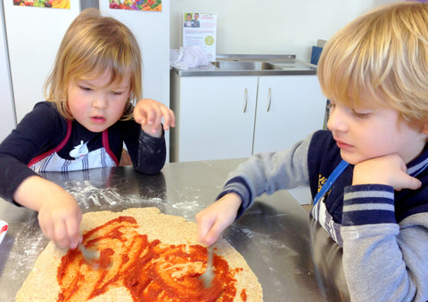 Chef Fern and her helpers making pizza pinwheels
