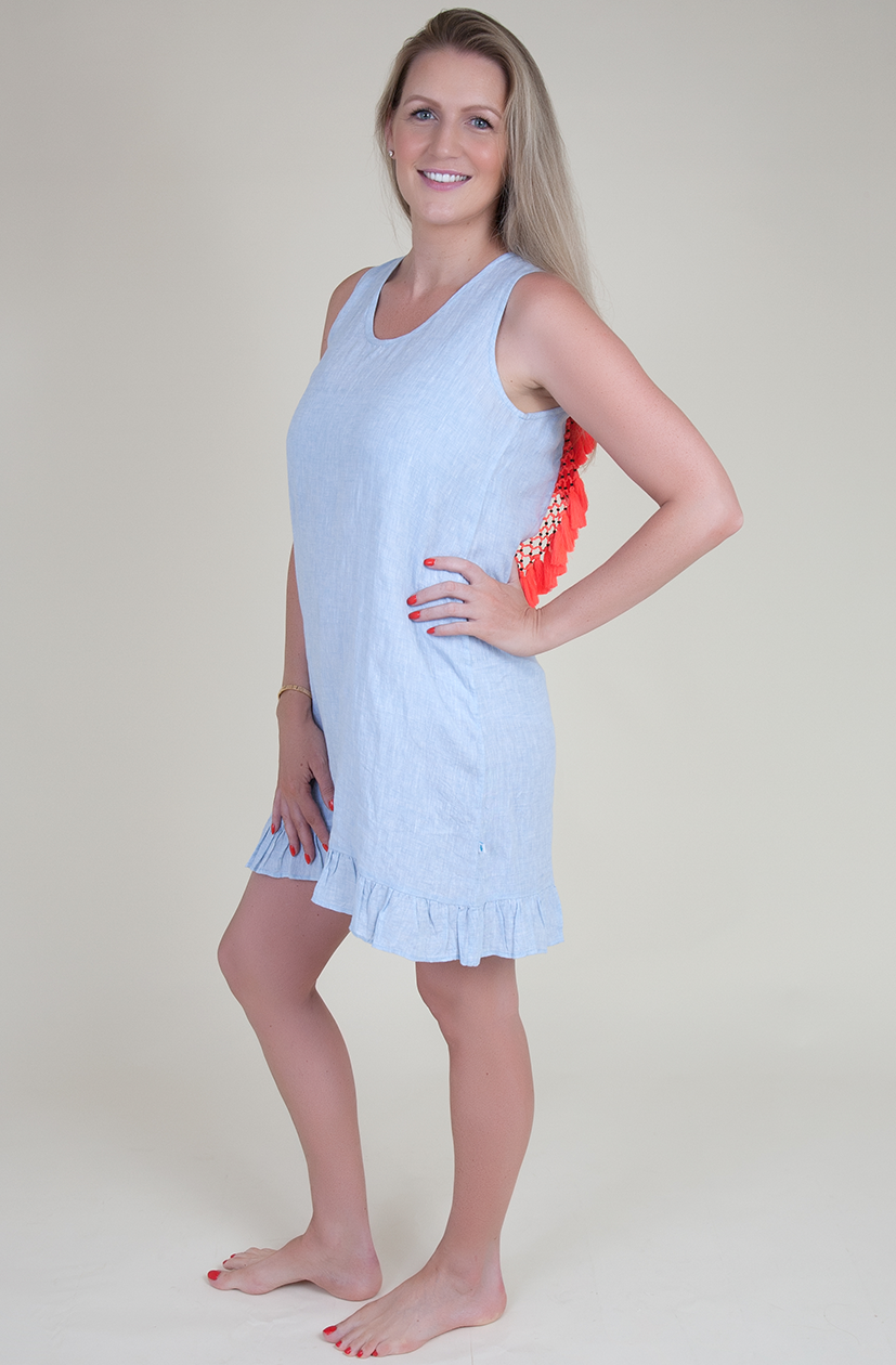 Backless linen dress with coral tassels
