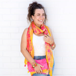 Intrinsic Happiness Tassel Scarf, bracelets and carnival pink clutch