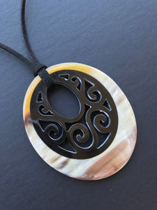 buffalo horn pendant with black cord necklace