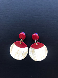Round statement earrings in red color and made of buffalo horn