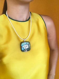 Wearing a square Labradorite sterling silver wire wrapped necklace on a yellow dress
