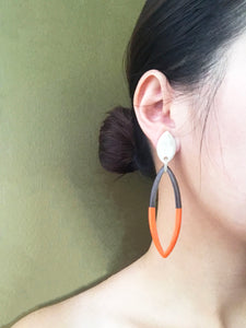 wearing orange buffalo horn earrings