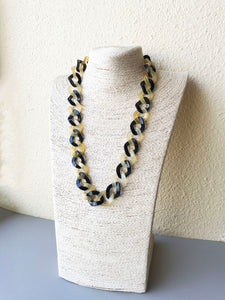 Contrast chain necklace on a necklace stand