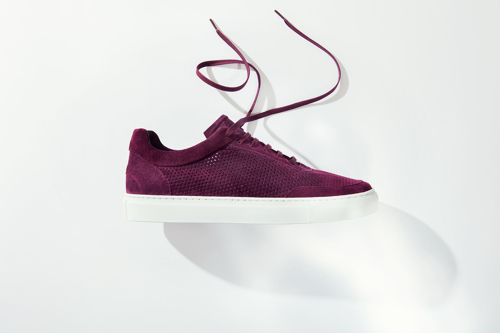 breathable perforated suede sneaker