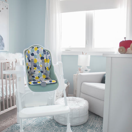 The Oribel Cocoon modern high chair in Pistachio Merengue. A perfect fit for modern nurseries.