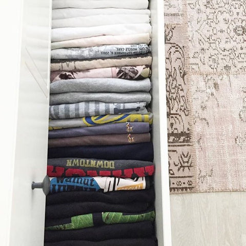 kid's closet filled with t-shirts