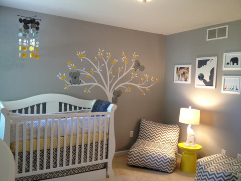 grey minimalistic baby room with cot