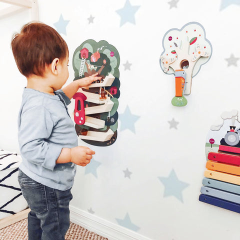 toddler playing with vertiplay wall toys