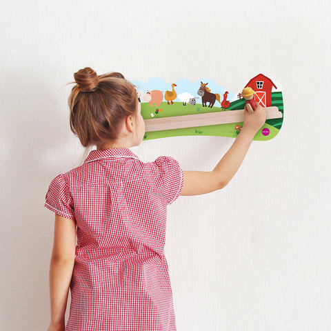 girl toddler in pink dress playing with VertiPlay Wall Toy: Old MacDonald