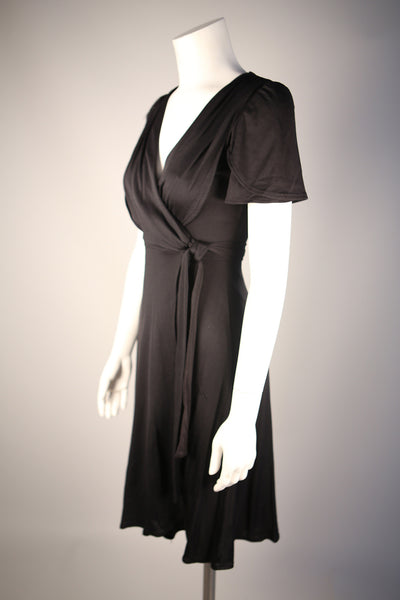 D109 - 1970s Black Knit Wrap Dress