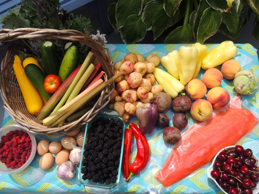 Our first non-grocery store shop/harvest consisted of produce from our garden, my mom's garden, and the fruit-stand. The salmon is from a local fisherman at the gov't wharf, and the berries we picked as a family :)