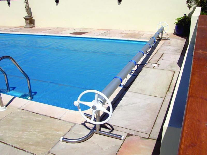 How can I lower my pool heating costs?