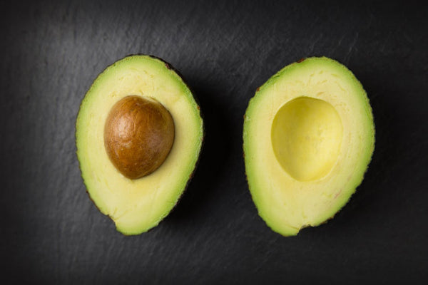 Natural skin moisturizer: an avocado, sliced in half to reveal the pit