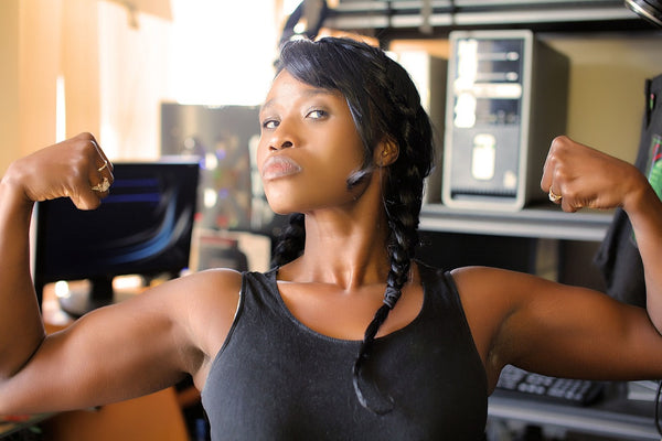 Organic deodorant: Woman flexes her arm muscles after a workout