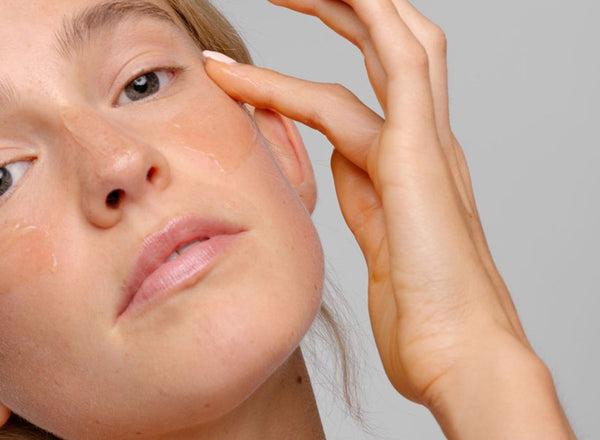 Natural Skin Care Products: Woman applying product to her face