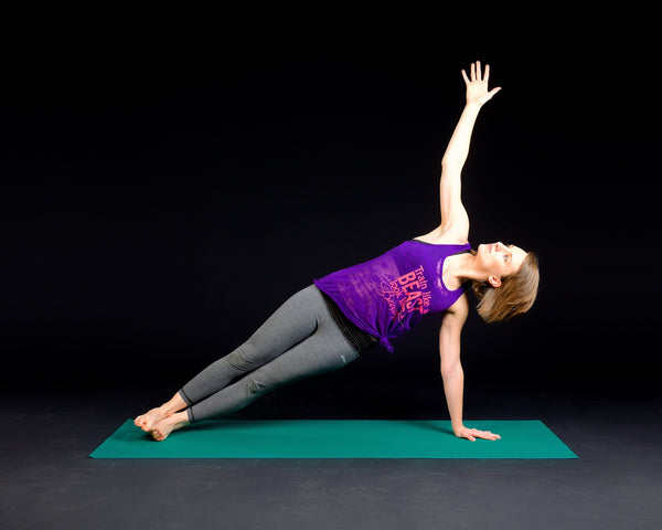 Organic deodorant: Woman performs a plank pose on a yoga mat