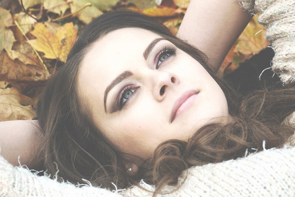 Natural Toner: Brunette girl laying in a pile of leaves