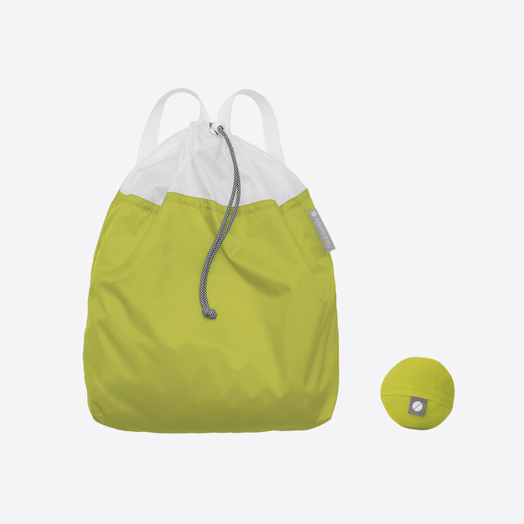 green drawstring backpack - the ultimate packable travel daypack for men and women, made from lightweight nylon.