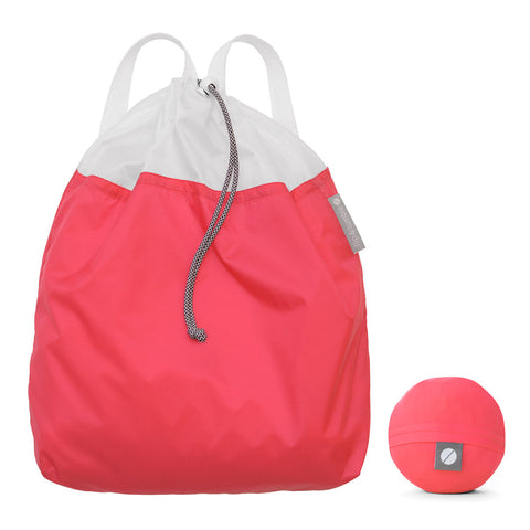 coral drawstring backpack - the ultimate packable travel daypack for men and women, made from lightweight nylon.