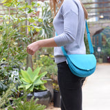 aqua purse on woman