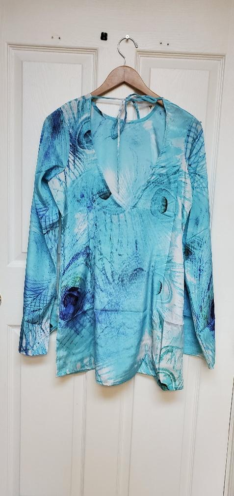 Silk designer dress, with dramatic sleeves