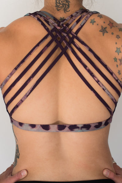 Amethyst Tie Dye purple with lavender highlights sports bra with full support with 4 criss cross straps on back.