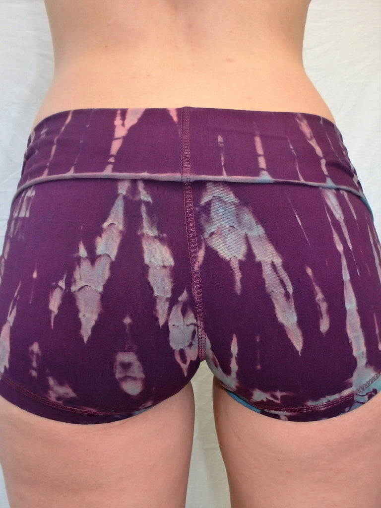 Lotus Tribe Clothing's curve hugging purple with lavender highlights tie dyed short shorts with fold over waist are soft and comfortable. Made in Bali of 90% cotton 10% spandex.