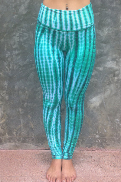 Long length yoga pants turquoise/teal tie dye. Fold over top for adjustable fit can be worn with higher waist or lower on the hips. 90% cotton 10% spandex. front view