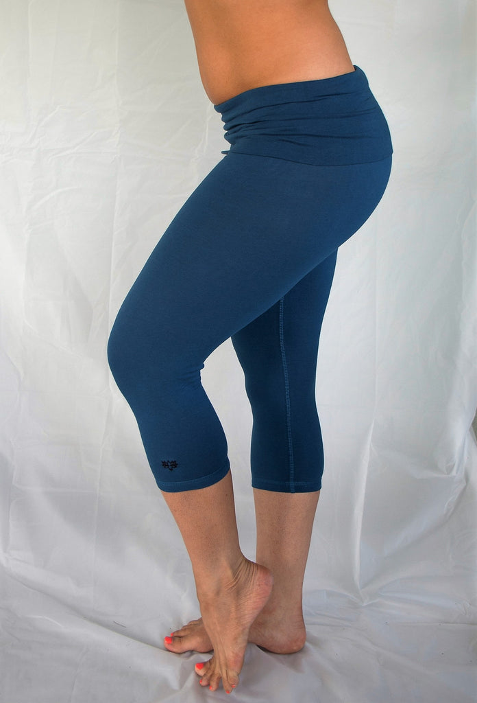 Solid colored cobalt blue 3/4 length Yoga Pants have a fold over waist that is adjustable to fit a longer torso or be worn lower on the hips. Soft 90% cotton and 10% spandex.