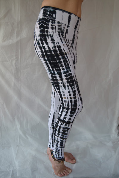 Long yoga pants in crisp black and white tie dye. Fold over top for adjustable fit can be worn with higher waist or lower on the hips. 90% cotton 10% spandex.