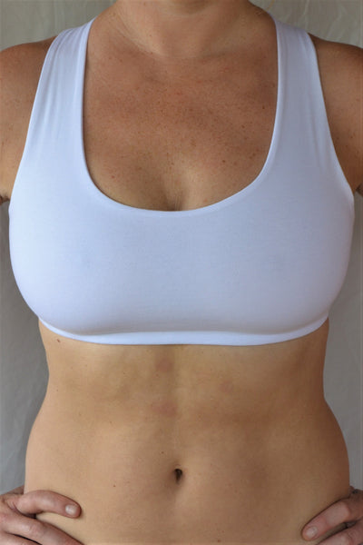 Soft, comfortable and super cute white sports bra with enough support for down dog and other yoga poses with 4 criss cross straps in back 90% cotton 10% spandex