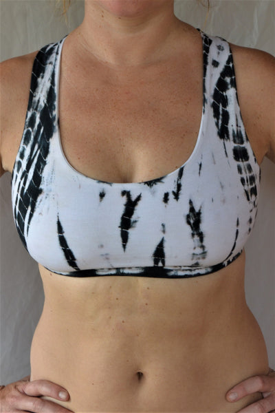 Soft, comfortable and super cute black and white tie dyed sports bra with criss cross straps on back.