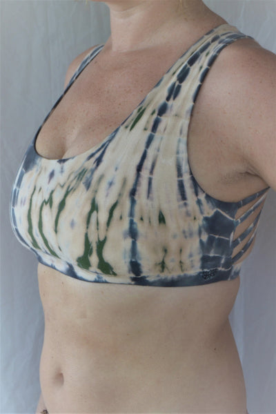 Soft, comfortable and super cute sports bra in peachy pink tie dye with green and grey highlights