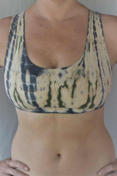 Soft, comfortable and super cute sports bra in peachy pink tie dye with green and grey highlights.