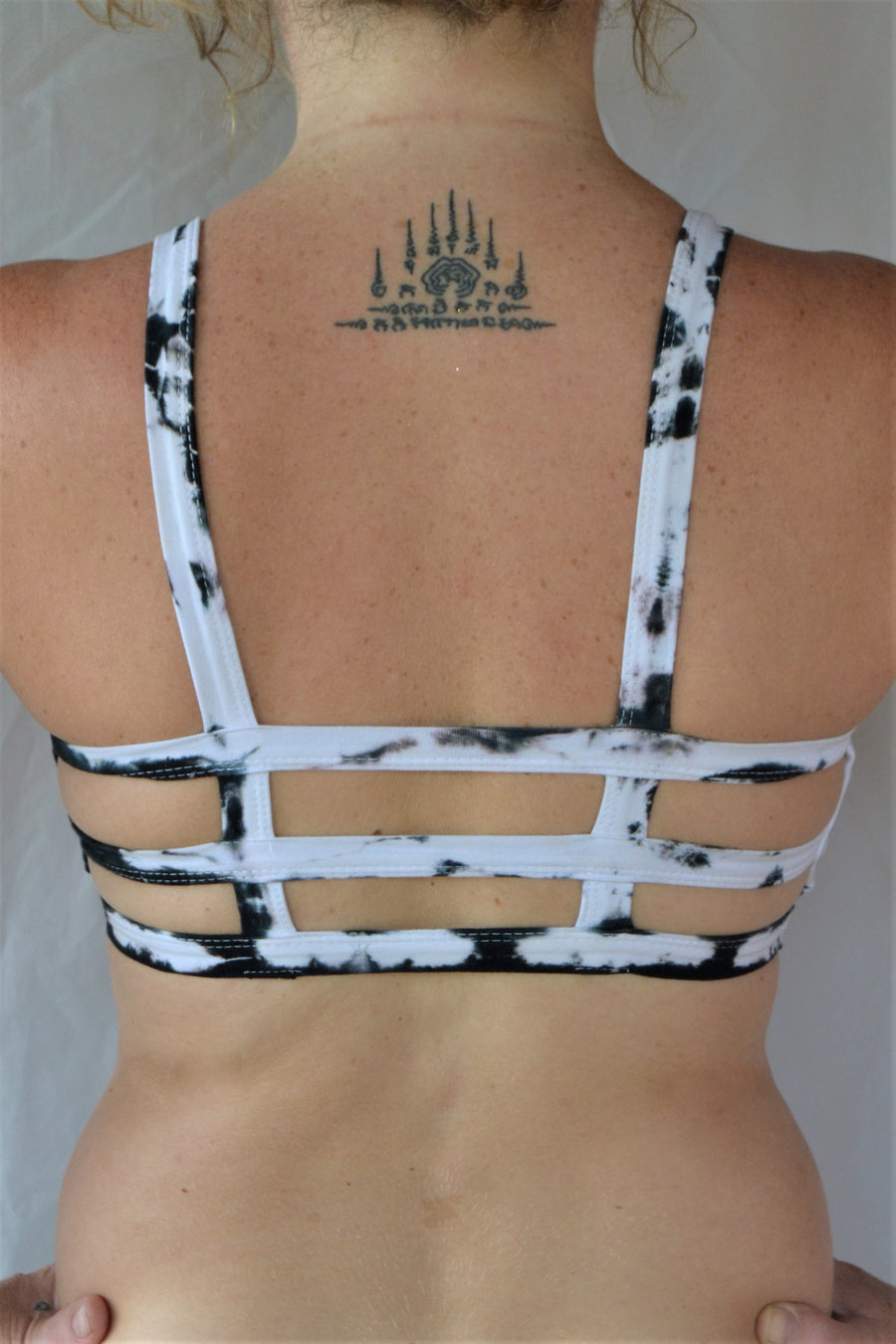 White with black tie dye sportsbra with three horizontal straps across the back. Incredibly comfortable with lighter support. Super soft 90% cotton 10% spandex