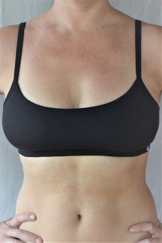 Enjoy a perfect state of zen in our basic, minimalist sportsbra. Solid black. Medium support, great for an active lifestyle with adjustable spaghetti straps.