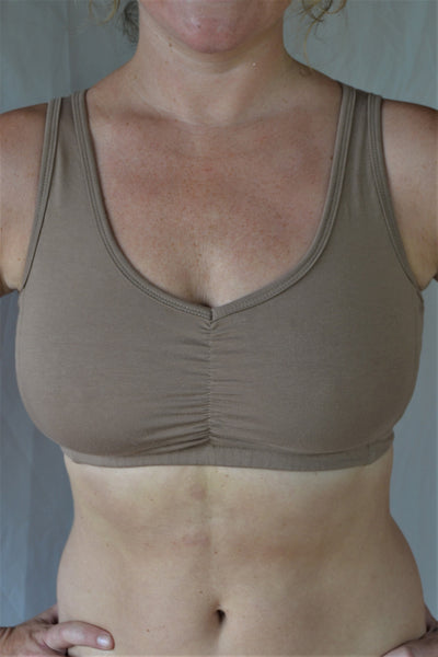 Sand (beige) SportsBra with sunburst design straps on back. Fits large chested active women especially while still being soft, cute, comfortable and functional.