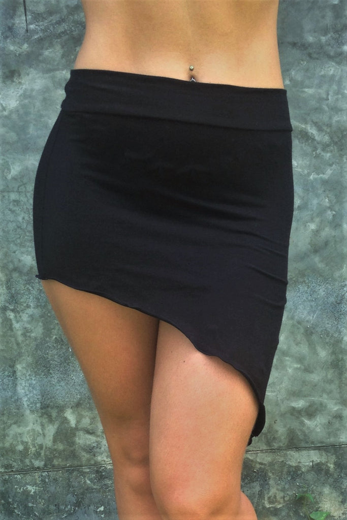 Festival Skirt by Lotus Tribe Clothing is a stretchy asymmetrical, easy to wear comfortable mini skirt. Looks great over bare legs or can be layered with leggings in cool er weather. Fold the top over or wear high waisted, custom form fits to your body shape. Soft and stretchy 90% cotton knit with 10% spandex.
