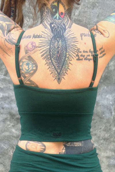Back view of Blissed Out Crop Tank with adjustable spaghetti straps in solid Forest green with small Lotus Flower embroidery on center bottom of back.
