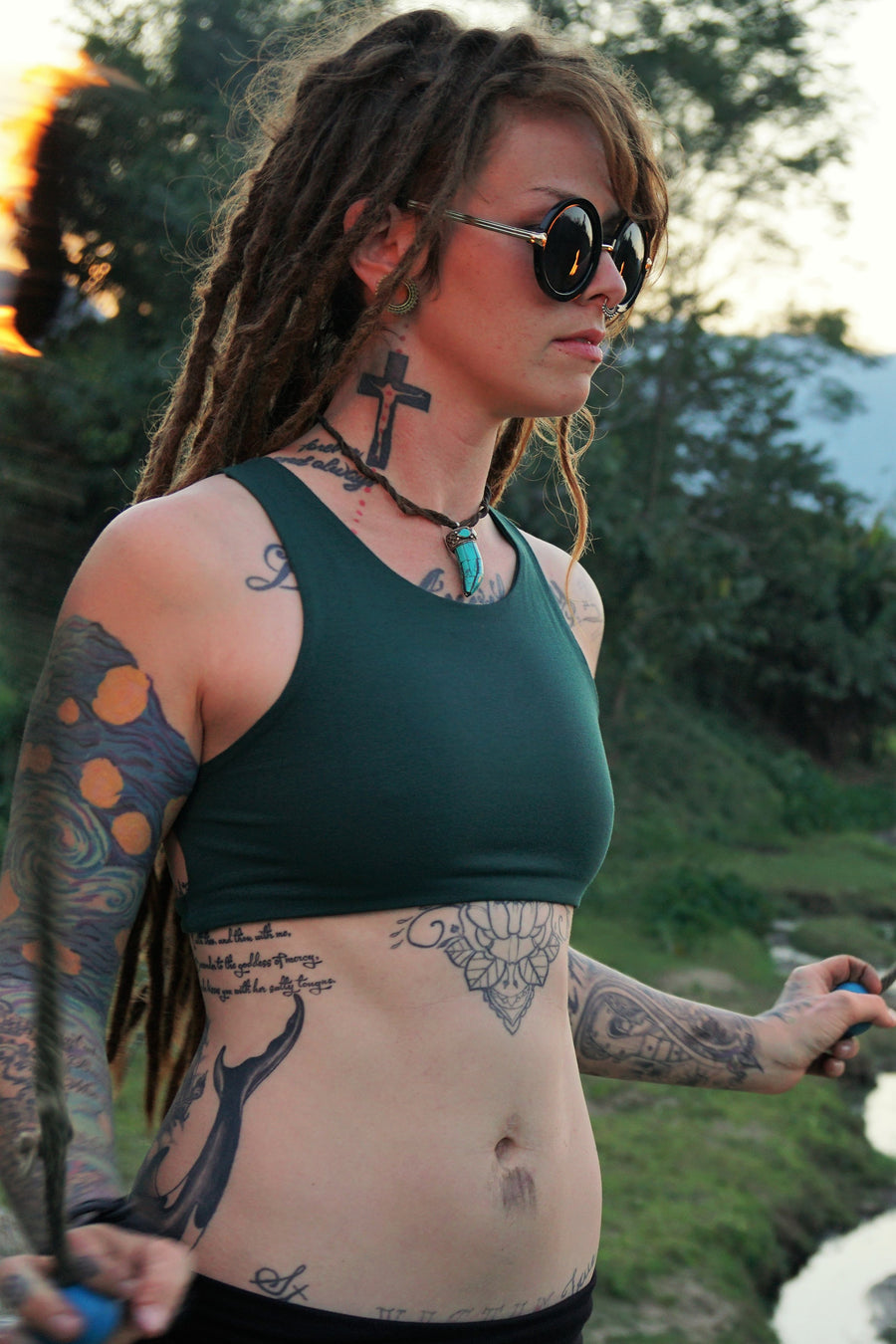 Forest green yoga crop top that has lace up back.
