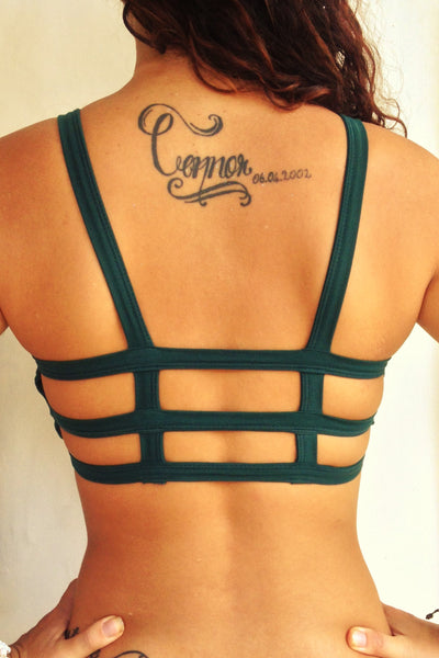 Back view of one of the most comfortable bras you will ever wear, soft and super cute with lighter support than our other bras. Solid Forest green front with 3 horizontal straps in back. 90% cotton 10% spandex. Made in Bali with love.