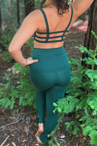 Forest green Yoga Pants with high waist that can be folded over shown from behind with matching Trinity Sportsbra.