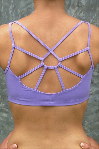 Lavender Sports Bra with sunburst design straps on back. Comes in sizes XS-XL but especially great for large chested active women while still being soft, cute, comfortable and functional.