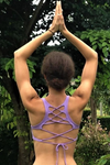 Lavender yoga crop top bra that accentuates the natural beauty of a woman's back with light support and lace up corset back, perfect for festival season.